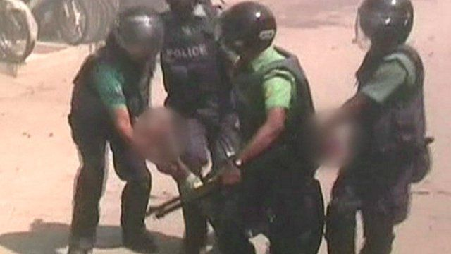 Police carry injured officer
