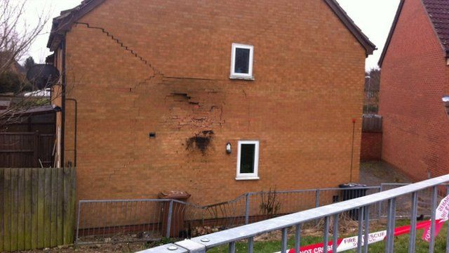 Hole in house where car crashed in Northampton