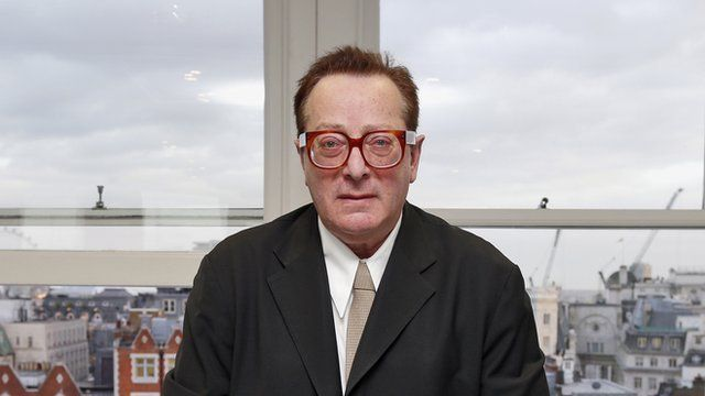 Lord Maurice Saatchi poses for photos at his office