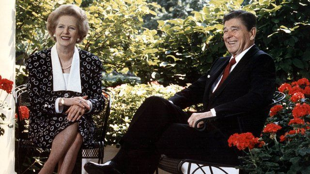 US President Ronald Reagan and former British Prime Minister Margaret Thatcher posing for photographers on the patio outside the Oval Office