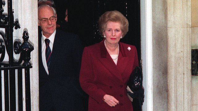 Margaret Thatcher, watched by husband Denis, at 10 Downing Street, London, before leaving for Buckingham Palace to offer resignation