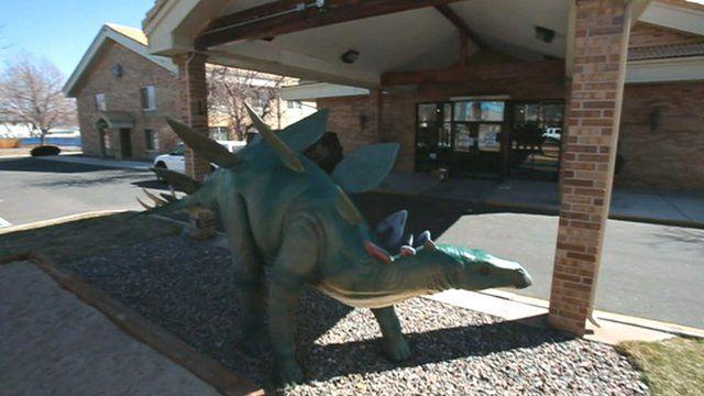 Dinosaur model outside hotel