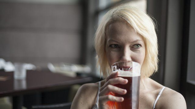 Woman drinking a pint of beer