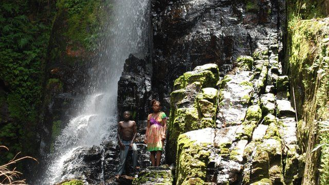 Villagers by the waterfall