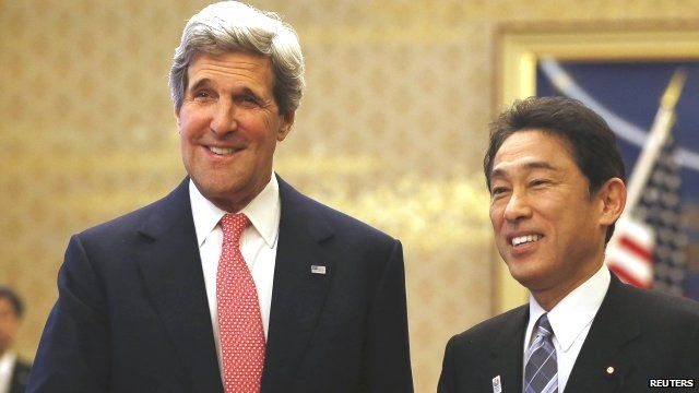 US Secretary of State Kerry shakes hands with Japans Foreign Minister Kishida in Tokyo
