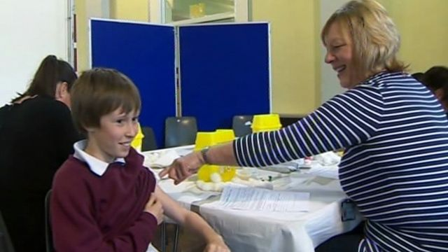 A pupil at Bishop Gore comprehensive at Sketty, Swansea, receives an MMR jab