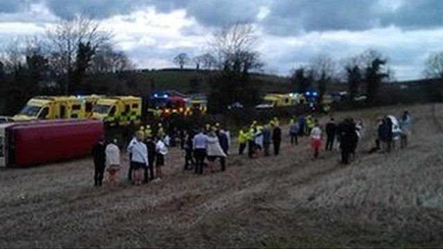 guests at the scene of the bus crash on the Ballynahinch Road