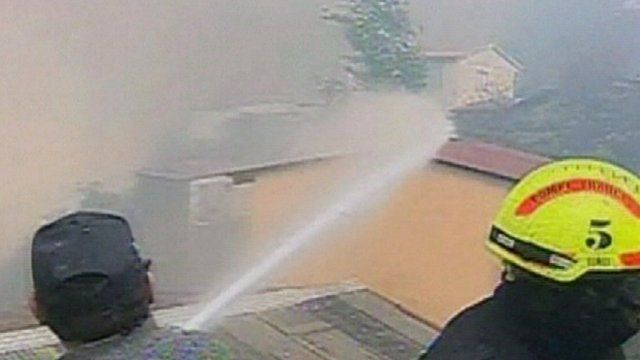 Fire-fighters battling flames in Valparaiso
