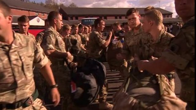 More than 100 families were waiting to welcome the troops.