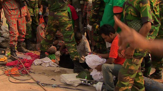 Rescuers pass oxygen and water to people who are trapped