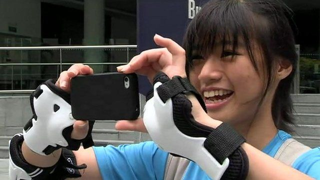 Young woman in Singapore using her smartphone