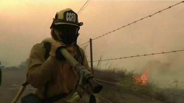 Firefighter with hose over shoulder