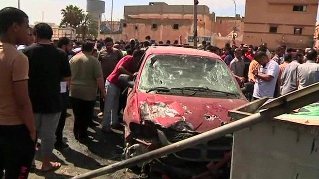 A damaged car in Benghazi
