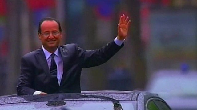 President Hollande waves from a car during his inauguration
