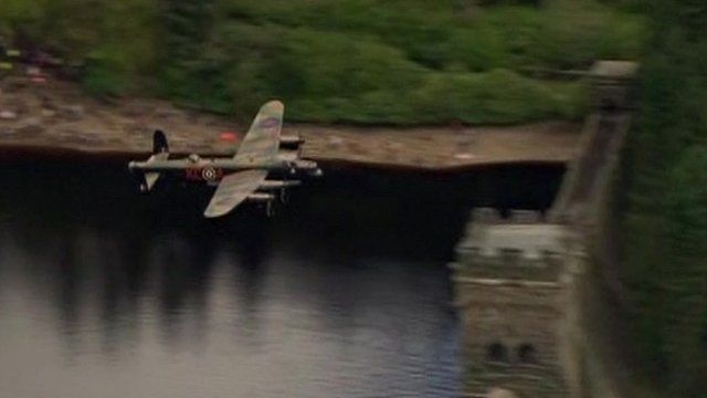 RAF Lancaster bomber flying over Derwent Dam