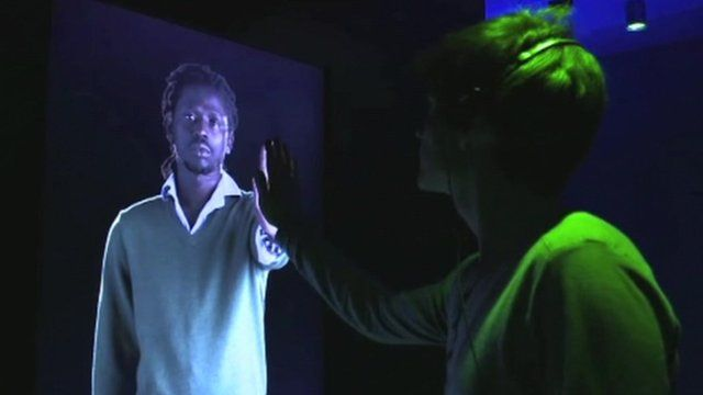 Visitor touching interactive screen