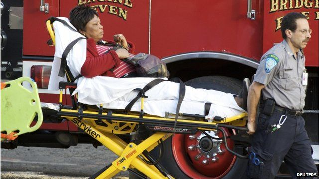 Woman carried in stretcher