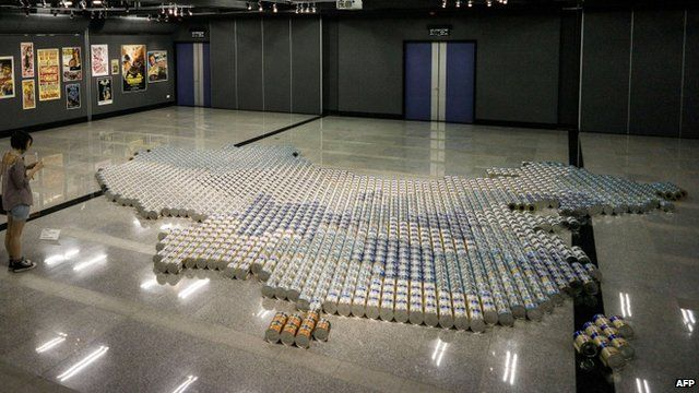A map of China contructed from tins of milk
