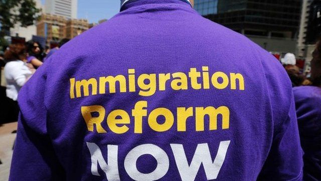 A man in a jumper printed with a slogan calling for immigration reform
