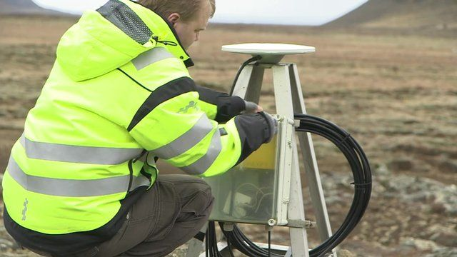 Benedikt Ofeigsson inspects a GPS monitor in Iceland