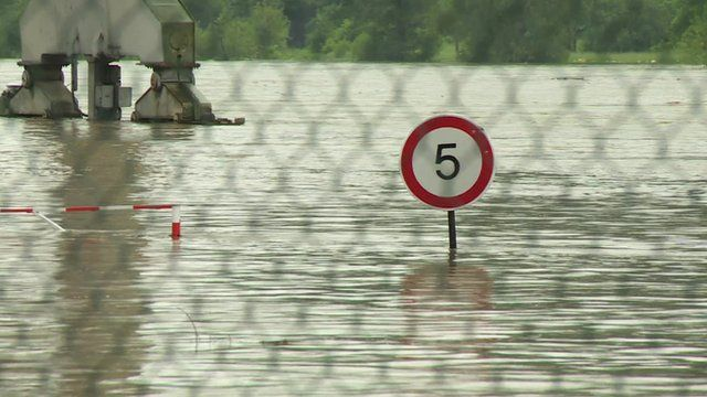 Road sign submerged