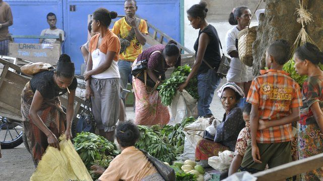 East Timorese vendors sell goods in the market in capital city of Dili