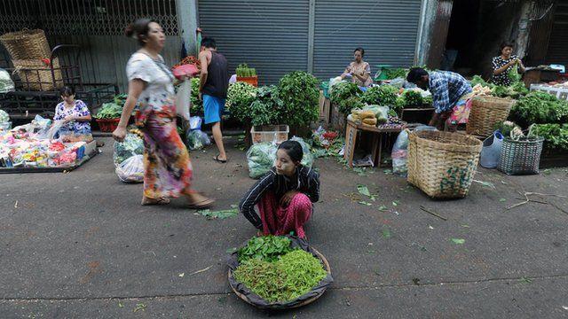 A Burmese vendor sells vegetables at a market in Rangoon