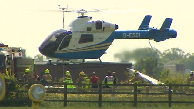 Helicopter lifting off at Cranfield Airport
