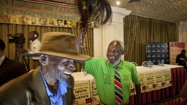 A Mau Mau veteran waves a a ceremonial whisk to celebrate