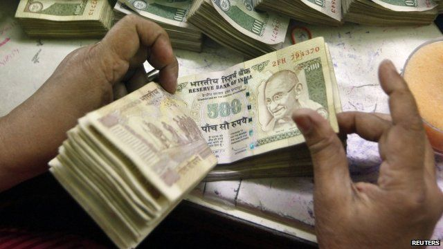 Rupees being counted
