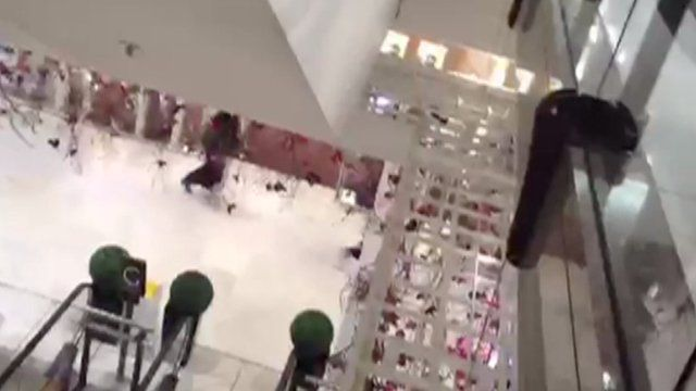 Men running out of Selfridges following the robbery