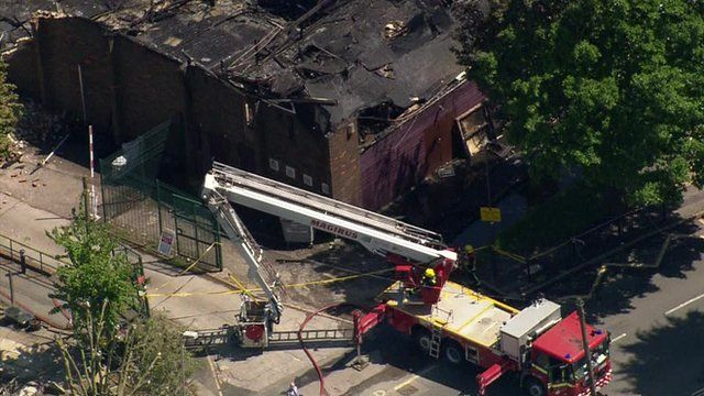 Aerial view of emergency vehicle at site of Islamic Darul Uloom school fire