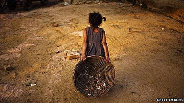 An Indian child working on a construction project