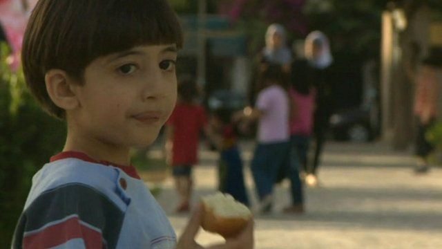 Child eating in Damascus