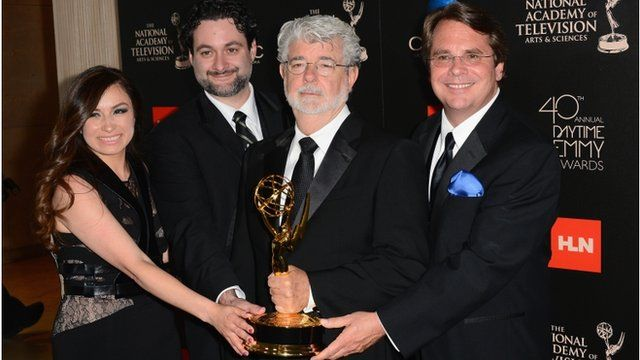 """Athena Portillo, Dave Filoni, George Lucas and Cary Silver pose with the Outstanding Special Class Animated Program award for """"Star Wars: The Clone Wars"""""""