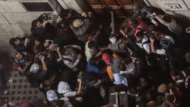 Students try to break down a door of the City Hall building in Sao Paulo, Brazil on June 18, 2013,