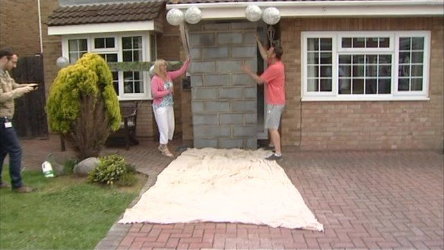 A couple return from their silver wedding anniversary to find their front door had been bricked up - just as it was after their honeymoon. & Doorway bricked up wedding prank repeated - BBC News Pezcame.Com