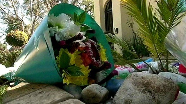 Flowers and messages of support for Nelson Mandela and his family