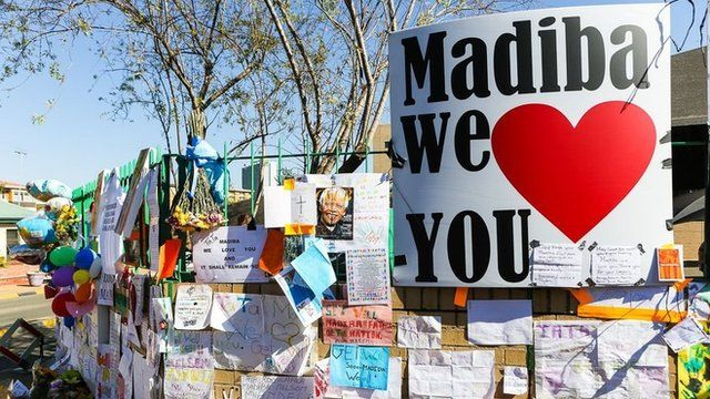 """Madiba we love you"" is a constant theme among the messages on the wall, referring to the former South African leader by his clan name"