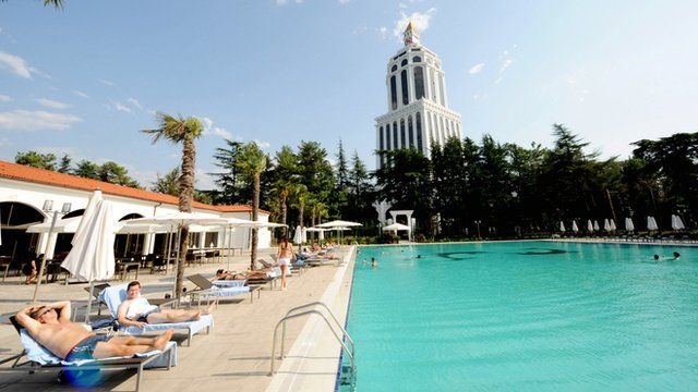 Sunbathers next to a pool at a luxury hotel in Batumi, Georgia