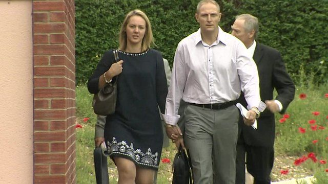 Sergeant Danny Nightingale (foreground) and his wife arrive at the military court