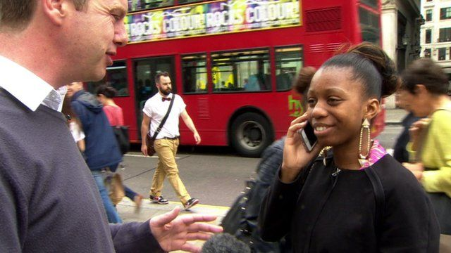 Woman on phone while talking to BBC reporter Graham Satchell