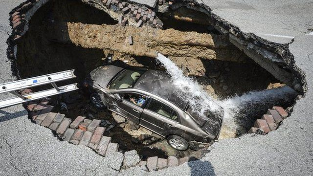 Car stuck in a sinkhole