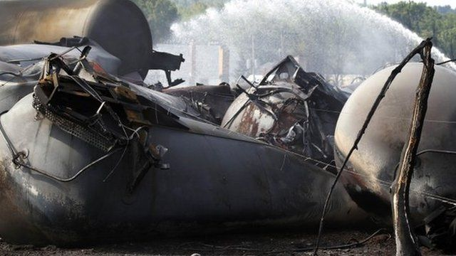 A burnt tree stands near the remains of a train derailment in Lac Megantic, Quebec