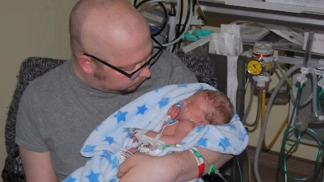 Chris Buckley with his baby son