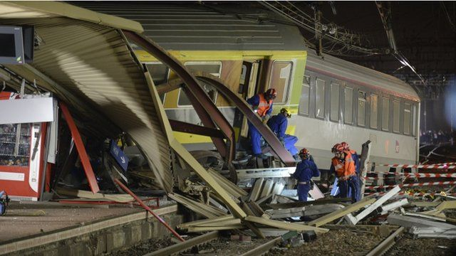 The mangled platform roof and derailed train cars are pictured early on July 13, 2013 at the site of a train accident at the railway station of Bretigny-sur-Orge, near Paris