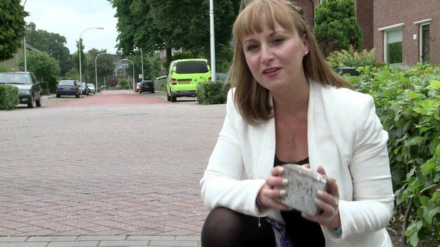 "Anna Holligan with a ""smog-eating"" paving stone"