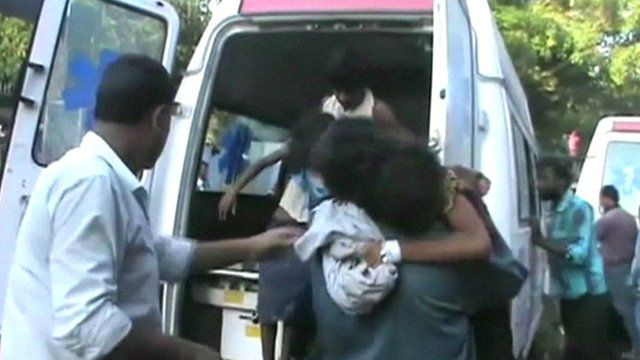 Children being carried from an ambulance