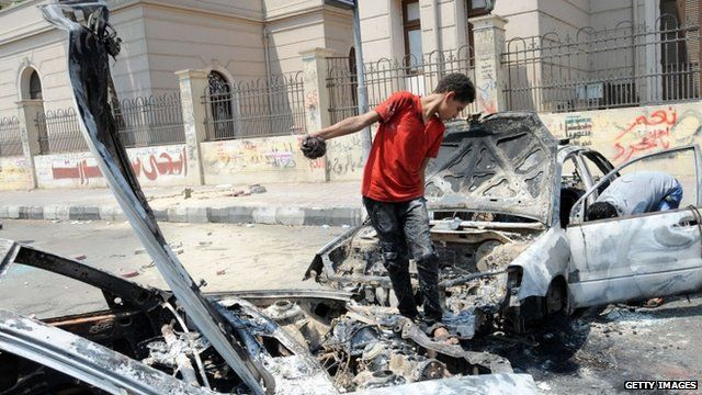 Child on burnt out cars