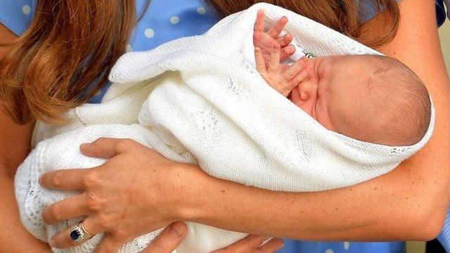 Prince George of Cambridge cradled by the Duchess of Cambridge